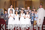 The boys & Girls from Scoil Bhreanáinn Portmagee who made their First Holy Communion on Saturday in St Patricks Church Portmagee pictured front l-r; Bryan Bolger, Julie Nugent, Gabriella da Silva, Lotta Gross, Sarah Coffey, Sean Kennedy, Noah Diosee, back l-r; Rosaleen Mullarkey, Kevin O'Connor, Adam Casey, Cian O'Sullivan, Aaron O'Sullivan & Fr David Gunn.