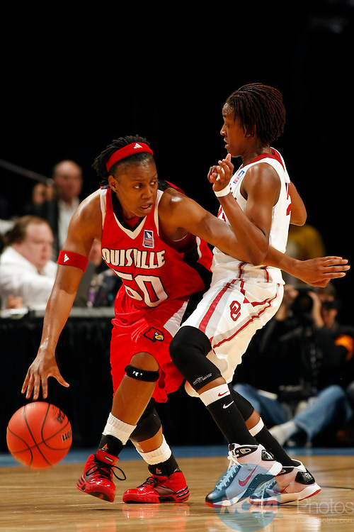 05 APR 2009:  Deseree' Byrd (50) of the University of Louisville looks for an opening against Danielle Robinson (13) of the University of Oklahoma during the Division I Women's Basketball Semifinals held at the Scottrade Center  in St. Louis, MO.  Louisville defeated Oklahoma 61-59 to advance to the national title game.  Jamie Schwaberow/NCAA Photos