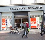 Dorothy Perkins shop shoppers walking in street, Cornhill, Ipswich, Suffolk, England, UK