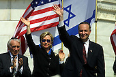 Washington, DC - April 15, 2002 -- United States Representative Ben Gilman (Republican of New York), U.S. Senator Hillary Rodham Clinton (Democrat of New York) and U.S. Senator Chuck Schumer (Democrat of New York) at the National Solidarity Rally with Israel at the  at the U.S. Capitol on Monday, April 15, 2002..Credit: Arnie Sachs / CNP