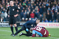 Neal Bishop (Scunthorpe) goes down hard<br />  - Scunthorpe United vs Worcester City - FA Challenge Cup 2nd Round Football at Glanford Park, Scunthorpe - 07/12/14 - MANDATORY CREDIT: Mark Hodsman/TGSPHOTO - Self billing applies where appropriate - contact@tgsphoto.co.uk - NO UNPAID USE
