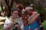 Photographer, Rikki Swenson, on a Photo Safari showing photos on her digital camera's LCD screen to Samburu tribal women in Kenya [NO MODEL RELEASE]