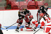 Kalley Armstrong (Harvard - 13), Kayla Tutino (BU - 8), Kaitlin Spurling (Harvard - 17) - The Boston University Terriers defeated the visiting Harvard University Crimson 2-1 on Sunday, November 18, 2012, at Walter Brown Arena in Boston, Massachusetts.