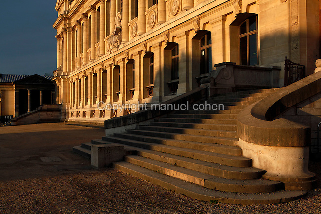 View from the side at sunrise of the Grande Galerie de l'Evolution (Great Gallery of Evolution) with the Gallery of Minerology and Geology in the background on the left, built by Jules Andre from 1877 to 1889 and located in the Jardin des Plantes, Paris, 5th arrondissement, France. Founded in 1626 by Guy de La Brosse, Louis XIII's physician, the Jardin des Plantes, originally known as the Jardin du Roi, opened to the public in 1640. It became the Museum National d'Histoire Naturelle in 1793 during the French Revolution. Picture by Manuel Cohen