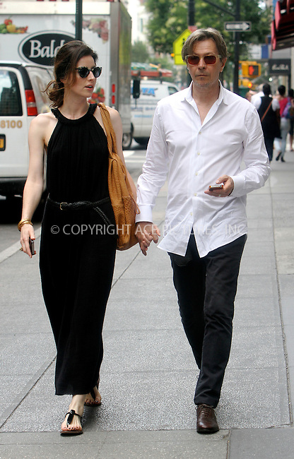 WWW.ACEPIXS.COM . . . . .  ....July 17 2012, New York City....Actor Gary Oldman and Alexandra Edenborough out in downtown Manhattan on July 17 2012 in New York City....Please byline: NANCY RIVERA- ACEPIXS.COM.... *** ***..Ace Pictures, Inc:  ..Tel: 646 769 0430..e-mail: info@acepixs.com..web: http://www.acepixs.com