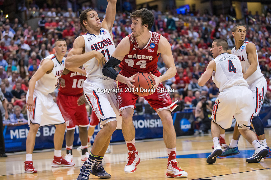 Arizona Wildcats forward Aaron Gordon (11) defends Wisconsin Badgers center Frank Kaminsky (44) during the Western Regional Final NCAA college basketball tournament game Saturday, March 29, 2014 in Anaheim, California. The Badgers won 64-63 (OT). (Photo by David Stluka)