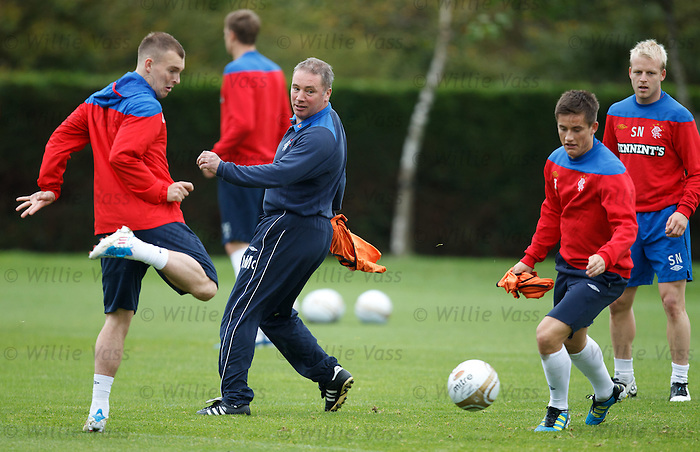 Gregg Wylde keeps the ball away from the mad machine that is Ally McCoist