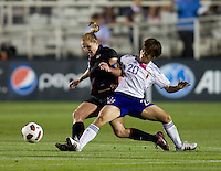 Rachel Buehler (19) of the USWNT fights for the ball with .Mana Iwabuchi (20) of Japan during the game at WakeMed Soccer Park in Cary, NC.   The USWNT defeated Japan, 2-0.