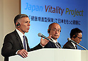 "July 21, 2016, Tokyo, Japan - Japan's insurer Sumitomo Life Insurance president Masahiro Hashimoto (C), accompanied by South African insurer Discovery Ltd. Chief executive Adrian Gore (L) and Japanese communication giant Softbank president Ken Miyauchi (R) announce Sumitomo will develop the new insurance product ""Japan Vitality Project"" with other two companies at a press conference in Tokyo on Thursday, July 21, 2016. The new life insurance has lower premiums to more healthy conscious people using health care devices or smartphones with health care applications. (Photo by Yoshio Tsunoda/AFLO) LWX -ytd-"