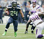 Seattle Seahawks running back Marshawn Lynch rushes for three of his 124 yards against Minnesota Vikings at CenturyLink Field in Seattle, Washington on  November 4, 2012.  Lynch rushed for 124 yards and scored one touchdown in the Seahawks 30-20 win over the Vikings.