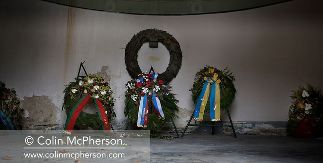 Commemorative wreaths lying in a tomb at the Soviet cemetery and war memorial in Schoenholzer Heide in former East Berlin. The site was used as a forced labour camp by the Germans during World War II but transformed by the Soviets into the final resting place for around half of the 22,000 Red Army personnel killed during the battle for berlin in 1945. Today, much of the site lies dilapidated and the victim of casual vandalism and decay.