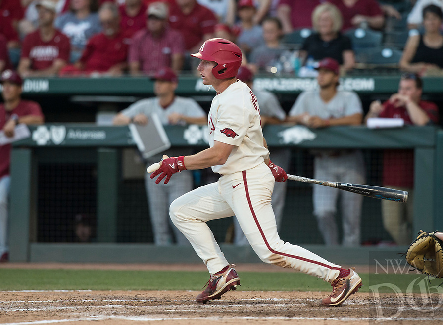 NWA Democrat-Gazette/BEN GOFF @NWABENGOFF<br /> Jax Biggers, Arkansas shortstop, watches after hitting the ball to center field for a RBI single in the 6th inning against South Carolina Saturday, June 9, 2018, during game one of the NCAA Super Regional at Baum Stadium in Fayetteville.