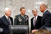 Washington, D.C. - September 10, 2007 -- United States Senator Richard Lugar (Republican of Indiana), ranking member, left, United States Army General David H. Petraeus, Commander of the Multi-National Force - Iraq (MNF-I), left center, United States Ambassador to Iraq Ryan Crocker, right center, and United States Senator Joseph Biden (Democrat of Delaware), chairman, share some thoughts prior to testimony on the future course of the war in Iraq at a hearing of the United States Senate Foreign Relations Committee, on Capitol Hill in Washington, D.C. on Tuesday, September 11, 2007..Credit: Ron Sachs / CNP.(RESTRICTION: No New York Metro or other Newspapers within a 75 mile radius of New York City)
