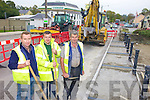 DIGGING DEEP: Some of the Kerry County Council staff busy laying new footpaths in Barraduff this week as part of the roadworks through the heavily potholed village.