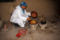 Near Skoura, Morocco - Aziz, Caretaker of the Ameridhil Kasbah, Prepares Lunch over a Charcoal Fire.