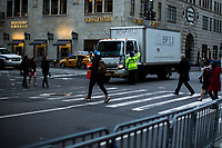 NEW YORK, NY - APRIL 4: A NYPD officers stops a truck to go along 5av as she takes care of traffic in front of Trump Tower Where United States First Lady Melania Trump is living on April 4, 2017 in Manhattan, New York. Police Commissioner James O'Neill told lawmakers in February it costs the NYPD between $127,000 and $146,000 a day to protect the first lady and her 11-year-old son Barron. When the president is in town, the city pays more than $308,000.  Photo by VIEWpress/Eduardo MunozAlvarez