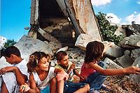 TIRO / SUD LIBANO - SETTEMBRE 2006.BAMBINI TRA LE MACERIE DELLA LORO CASA DISTRUTTA DAI BOMBARDAMENTI ISRAELIANI..ORDIGNI INESPLOSI E CLUSTER BOMBS CAUSANO QUOTIDIANAMENTE GIOVANI VITTIME NELLE ZONE COLPITE DURANTE I 34 GIORNI DI CONFLITTO CHE NEL'ESTATE 2006 HA CONTRAPPOSTO L'ESERCITO ISRAELIANO AI GUERRIGLERI HEZBOLLAH NEL SUD DEL LIBANO..FOTO LIVIO SENIGALLIESI..TYR / SOUTH LEBANON - SEPT.2006.LEBANESE CHILDREN AMOUNG THE RUINS OF THEIR HUOSE DESTROYED BY ISRAELI AIR STRIKES..PHOTO LIVIO SENIGALLIESITIRO / SUD LIBANO - SETTEMBRE 2006.BAMBINI TRA LE MACERIE DELLA LORO CASA DISTRUTTA DAI BOMBARDAMENTI ISRAELIANI..ORDIGNI INESPLOSI E CLUSTER BOMBS CAUSANO QUOTIDIANAMENTE GIOVANI VITTIME NELLE ZONE COLPITE DURANTE I 34 GIORNI DI CONFLITTO CHE NEL'ESTATE 2006 HA CONTRAPPOSTO L'ESERCITO ISRAELIANO AI GUERRIGLERI HEZBOLLAH NEL SUD DEL LIBANO..FOTO LIVIO SENIGALLIESI..TYR / SOUTH LEBANON - SEPT.2006.LEBANESE CHILDREN AMOUNG THE RUINS OF THEIR HUOSE DESTROYED BY ISRAELI AIR STRIKES..PHOTO LIVIO SENIGALLIESI