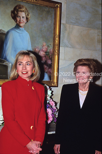 First lady Hillary Rodham Clinton and former first lady Betty Ford pose in front of Ford's portrait in the White House in Washington, D.C. on March 2, 1993..Credit: Jeff Markowitz / Pool via CNP