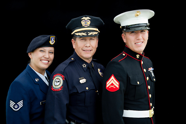 Native American family of soldiers is sister and brother Brittinie Alvarez (Airforce) and Blake Alvarez (Marine), pose with father who is police officer of the Isleta Pueblo.