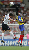 English midfielder (16) Owen Hargreaves goes up for a header against Ecuadorian forward (11) Agustin Delgado.  England defeated Ecuador, 1-0, in their FIFA World Cup round of 16 match at Gottlieb-Daimler-Stadion in Stuttgart, Germany, June 25, 2006.