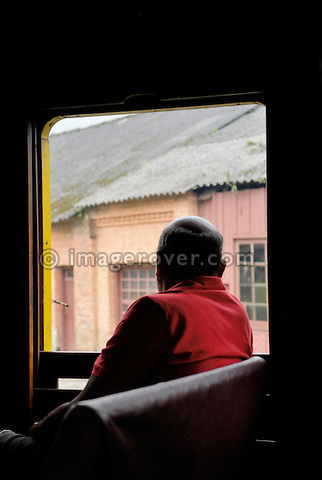 Man watching out of a historic steam train at Paranapiacaba station; near Sao Paulo, Brazil. In 1856 the British-owned Sao Paulo Railway Company was awarded the concession to operate a rail line between the port of Santos and Jundai, 70km north of Sao Paulo city, in what was then a developing coffee-growing region. The 139km line was completed in 1867, remaining under British control until 1947. Overcoming the near-vertical incline of the Serra do Mar that separates the interior of the state from the coast, the line was using the largest funicular system in the world and was regarded as an engineering miracle. --- No releases available.
