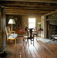 This 18th century 'keeping room' with rough-hewn beams is where the family originally would have cooked using the wide fireplace and its beehive oven