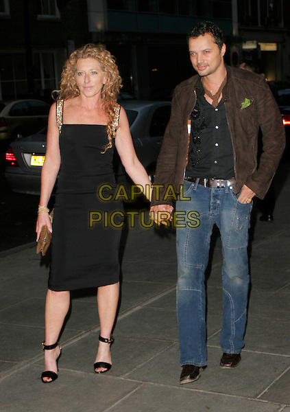 KELLY HOPPEN & GERRY DeVAUX.Attends Suka, An evening at Sanderson in aid of CLIC Sargent, The Sanderson, Berners Street,.London, England, May 15th 2007..full length black dress holding hands de Vaux gold sequined shoulder straps ankle strap shoes clutch bag.CAP/AH.©Adam Houghton/Capital Pictures.