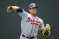 Catcher Bryan De La Rosa (26) of the Rome Braves warms up before a game against the Greenville Drive on Sunday, June 14, 2015, at Fluor Field at the West End in Greenville, South Carolina. Rome won, 5-2. (Tom Priddy/Four Seam Images)