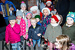 Local Children surround Santa at the turning on of the lights in Ballybunion on Sunday evening.