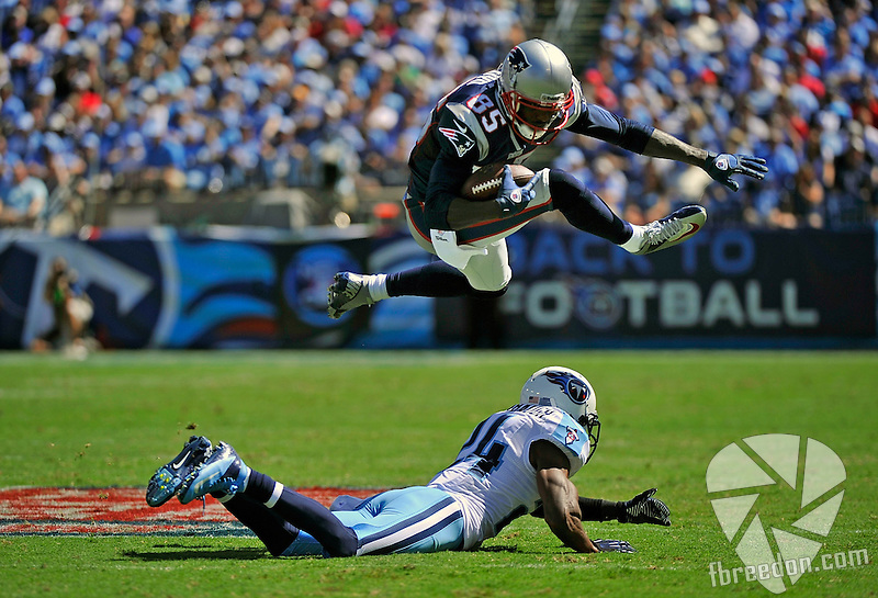 NASHVILLE, TN - SEPTEMBER 09:  Brandon Lloyd #85 of the New England Patriots jumps over Coty Sensabaugh #24 of the Tennessee Titans at LP Field on September 9, 2012 in Nashville, Tennessee.  (Photo by Frederick Breedon/Getty Images) *** Local Caption *** Brandon Lloyd; Coty Sensabaugh