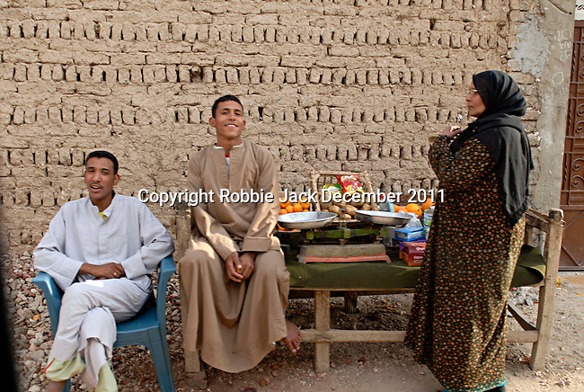 Local people at a fruit and vegatable stall in a small village on the west bank near Luxor .The town of Luxor occupies the eastern part of a great city of antiquity which the ancient Egytians called Waset and the Greeks named Thebes.