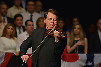 MIAMI, FL - JUNE 16: Luis Haza plays the US National Anthem as US President Donald Trump (R) listens at the Manuel Artime Theater in Miami, Florida, on June 16, 2017. Trump denounced Raul Castro's 'brutal' Cuban regime on Friday in a speech to Cuban-American exiles vowing to restore 'freedom' to their homeland. Credit: MPI10 / MediaPunch