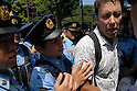 Canadian tourist Pierre Pariseau is taken to a police box after a brief confrontion with supporters of Gen. Toshio Tamogami during commerations marking the 64th anniversy of the end of World War Two at Yausukuni shrine in Tokyo, Japan on Aug 15th 2009.(Photo by Bruce Meyer/Nippon News).