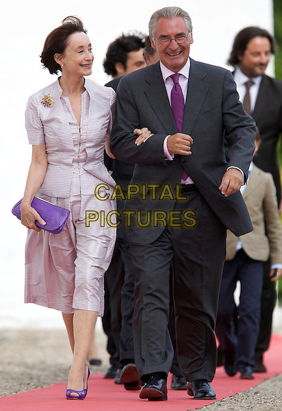 FRANCOISE GRASSIOT & ALAIN CAVALLIER.The Christening of Prince Henrik Carl Joachim Alain of Denmark at Mogeltonder Church, Mogeltonder, Denmark..July 26th, 2009 .royals royalty full length purple jacket suit black clutch bag arms linked.CAP/PPG/JH.©Jens Hartmann/People Picture/Capital Pictures