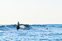 Stand-up paddle surfer at Poipu Beach, Kauai Hawaii