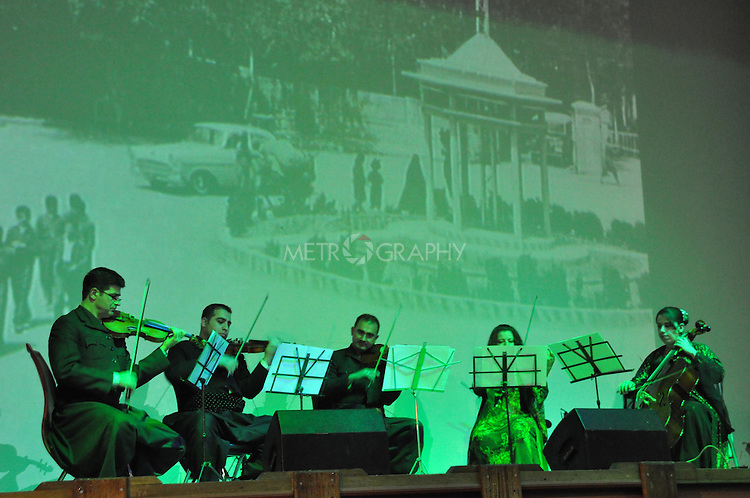 SULAYMANIYAH, IRAQ: Musicians play traditional music against a backdrop of photographs of the city of Sulaimaniyah...November 14, 2010, Sulaymaniyah celebrates its 225th birthday...Photo by Aram Karim/Metrography