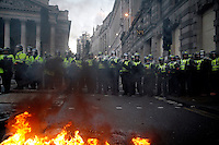 Police block the road in front of the Royal Exchange as thousands of protestors descended on the City of London ahead of the G20 summit of world leaders to express anger at the economic crisis, which many blame on the excesses of capitalism.