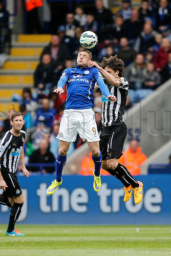 02.05.2015.  Leicester, England. Barclays Premier League. Leicester City versus Newcastle United. Jamie Vardy of Leicester City and Fabricio Coloccini of Newcastle United compete for a high ball.