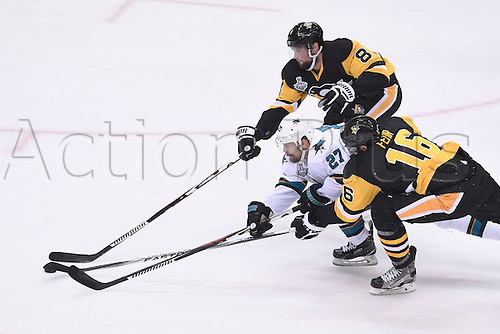30.05.2016. Pittsburgh, PENN, USA.  San Jose Sharks right wing Joonas Donskoi (27) skates the puck between Pittsburgh Penguins defenseman Brian Dumoulin (8) and Pittsburgh Penguins right wing Eric Fehr (16) during the first period of Game One in the 2016 NHL Stanley Cup Final between the San Jose Sharks and the Pittsburgh Penguins at the Consol Energy Center in Pittsburgh, Pennsylvania.   The Penguins scores late in the game for a 3-2 home win.