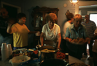 Family members visit at the end of a reunion of the Caudill family at their homestead in Mud, W.V. The family fought the coal company in court to protect their ancestral home which stood in the way of plans to expand a the mine. The West Virginia Supreme Court ruled in 2004 that the Lincoln County family was wrongly forced to sell its home place to make way for a mountaintop removal mine. Justices said a lower court was wrong to discount the family's 'sentimental or emotional interests' in the property in favor of the economic concerns of a coal operator.""