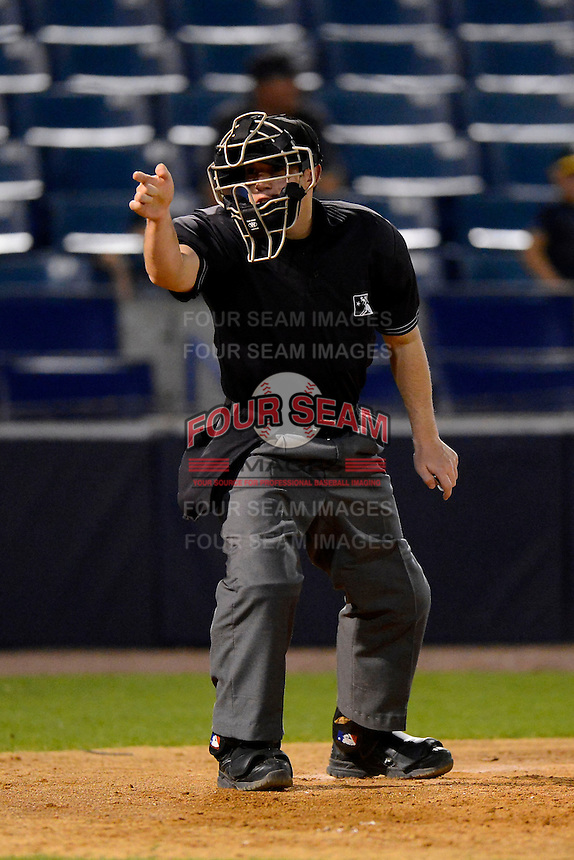 Umpire Rich Gonzalez makes a call during a game between the Tampa Yankees and Lakeland Flying Tigers at Steinbrenner Field on April 6, 2013 in Tampa, Florida.  Lakeland defeated Tampa 8-3.  (Mike Janes/Four Seam Images)