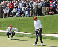 28 SEP 12  Jim Furyk line up a birdie putt as Brandt Snedeker  looks on during Fridays morning foresome matches  at The 39th Ryder Cup at The Medinah Country Club in Medinah, Illinois.