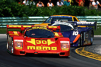 ELKHART LAKE, WI - JULY 16: The MOMO/Gebhardt Racing Porsche 962C 001GS of Gianpiero Moretti and Jean-Louis Riccii leads a group of cars during the Miller High Life 500 IMSA GT race at the Road America track near Elkhart Lake, Wisconsin, on July 16, 1989.