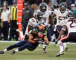 Seattle Seahawks wide receiver Jermaine Kearse (15) is tackled by Chicago Bears cornerback Charles Tillman (33) in the first quarter of a pre-season game at CenturyLink Field in Seattle, Washington on August 22, 2014.   The Seahawks beat the Bears 34-6.  Kearse caught 4 passes for 63 yards and scored one touchdown in the win. ©2014.  Jim Bryant Photo. ALL RIGHTS RESERVED.