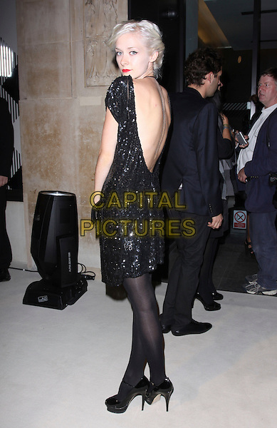 PORTIA FREEMAN .Attending the After Show Party for  Burberry during London Fashion Week, Burberry headquarters, London, England, UK, .September 22nd 2009..full length black dress looking back over shoulder rear behind low beaded tights shoes platform patent YSL tribute shoes peep toe ankle strap.CAP/AH.©Adam Houghton/Capital Pictures.