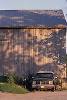 Farm Pickup Truck in Front of Barn on Sunny Summer Evening