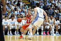 CHAPEL HILL, NC - JANUARY 11: Curran Scott #10 of Clemson University drives against Andrew Platek #3 of the University of North Carolina during a game between Clemson and North Carolina at Dean E. Smith Center on January 11, 2020 in Chapel Hill, North Carolina.