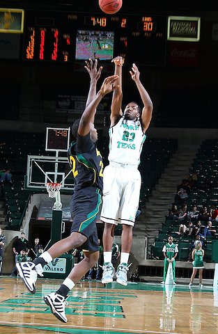 DENTON, TX - DECEMBER 16:  Jordan Williams #23 of the North Texas Mean Green shoots over Jeremy Campbell #22 of the Southeastern Louisiana Lions at the UNT Coliseum on December 16, 2012 in Denton, Texas. (Photo by Rick Yeatts/Getty Images)