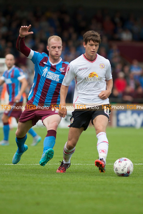 Neil Bishop of Scunthorpe Utd with George Cooper of Crewe A<br /> during Scunthorpe United vs Crewe Alexandra, Sky Bet League 1 Football at Glanford Park, Scunthorpe, England on 15/08/2015