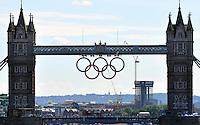 24.07.2012. London England. A Double Decker Bus drives across Tower Bridge in London